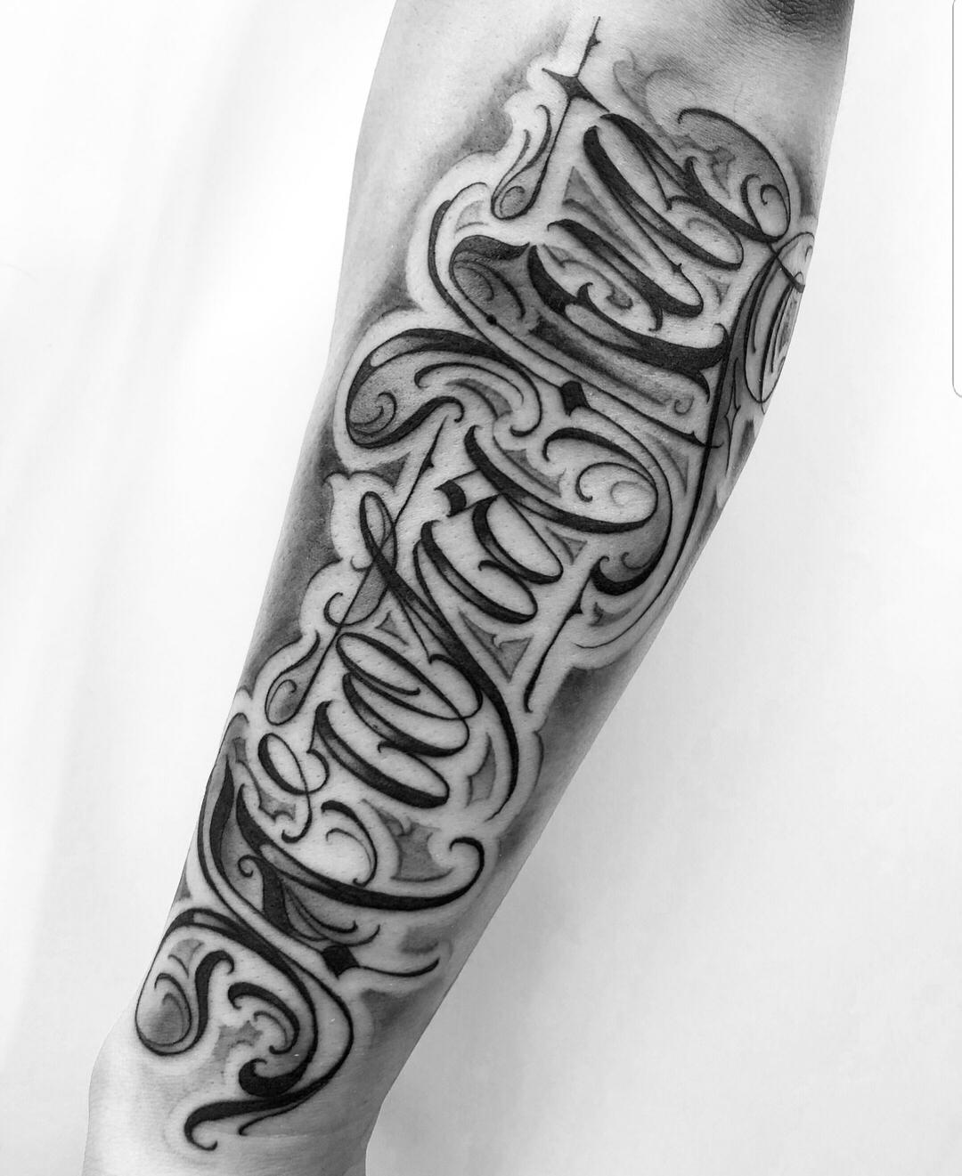 Jaw Line Tattoos: Lettering Tattoos
